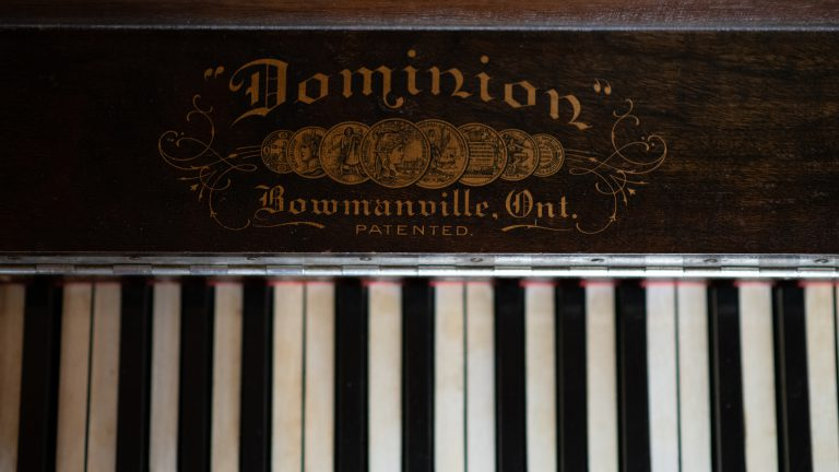 close up of antique piano keys from above
