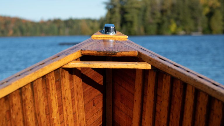 front end of an antique cedar water taxi from the perspective of sitting inside the boat
